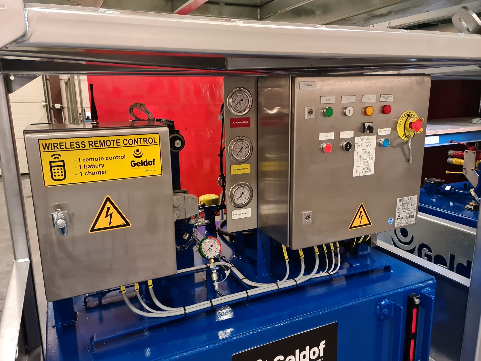The hydraulic power packs with the hand control integrated in the cabinet.